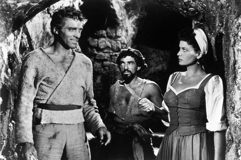 Consuelo (Eva Bartok, re.), die Tochter des Rebellenführers El Libre, befreit Vallo (Burt Lancaster, li.) und Ojo (Nick Cravat, Mi.) von ihren Fesseln. – Bild: ARTE / © Warner Bros.