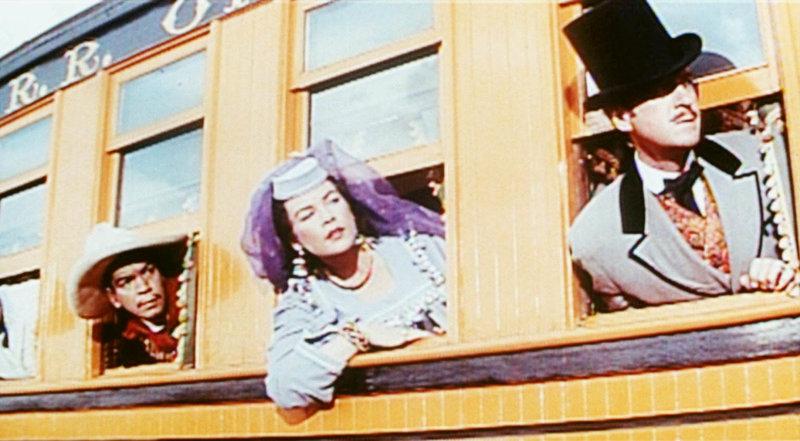 In der jungen Witwe Aouda (Shirley MacLaine, M.) finden Sir Phileas Fogg (David Niven, r.) und sein Diener Passepartout (Cantinflas, l.) eine treue Begleiterin. – Bild: KAB; ProSieben Media AG