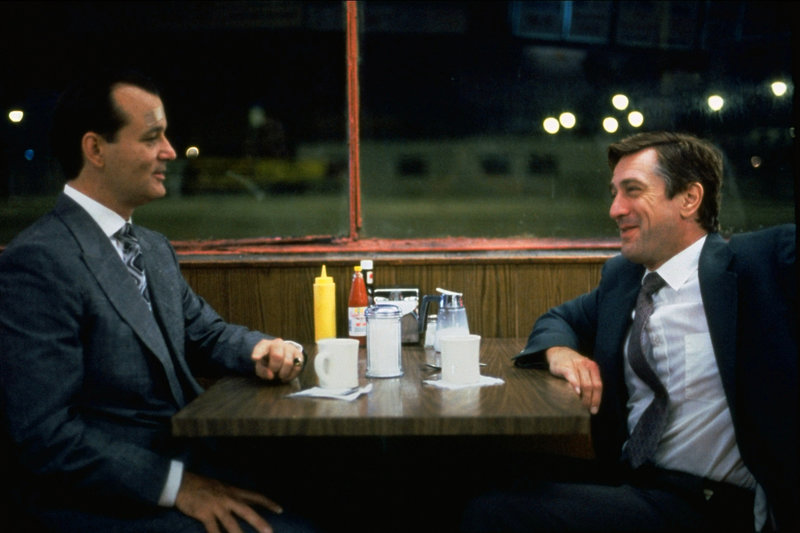 Der Chicagoer Polizist Wayne Dobie (Robert De Niro, r.) wird zufällig Lebensretter des Mafiabosses Frank Milo (Bill Murray, l.). Der will sich nun auf ganz besondere Art und Weise bei ihm bedanken ... – Bild: 1993 Universal City Studios. All Rights Reserved. Lizenzbild frei