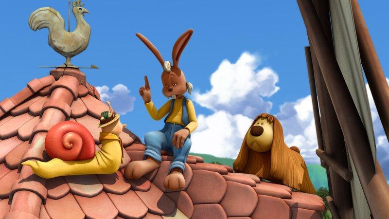 Beim Versuch Pollux zu retten, landen auch noch Hugo, die Schnecke, und Castor, der Hase, auf dem Dach der Windmühle. – Bild: KiKA