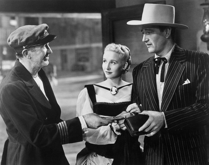 Vera Ralston (M.), John Wayne (r.) – Bild: KIRCH MEDIA GMBH & CO KG AA