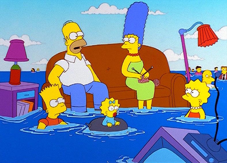 Von Delphinen verjagt, landen Homer, Marge, Bart, Maggie und Lisa Simpson und die anderen Einwohner Springfields im Meer. – Bild: ORF