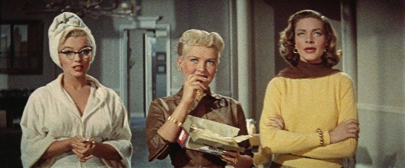 Die drei Frauen Pola (Marilyn Monroe, li.), Loco (Betty Grable, Mi.) und Schatze Page (Lauren Bacall, re.) verfolgen das gleiche Ziel: Alle sind auf der Suche nach einem heiratswilligen Millionär ... – Bild: KIRCH MEDIA GMBH & CO KG AA