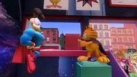 """Jon, Garfield und Odie werden Zeugen eines dreisten Raubes im Comicladen. Zeit für Garfield und Odie, alias """"Rächer mit dem Umhang"""" und """"Schlabberzunge"""", für Recht und Ordnung zu sorgen. – © HR/DARGAUD MEDIA"""
