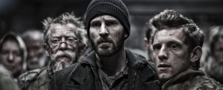 """Snowpiercer"": Chris Evans (m.), John Hurt (l.) und Jamie Bell (r.) im Originalfilm – Bild: Moho Film"